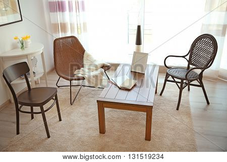 Modern living room interior. Different kinds of chair around table.