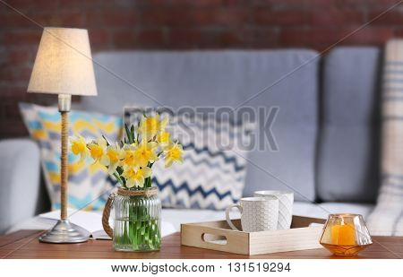 Yellow narcissus in living room interior