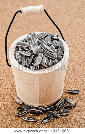 Sunflower seeds in a wooden casks on table.