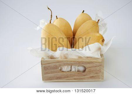 yellow mango arranged in a row