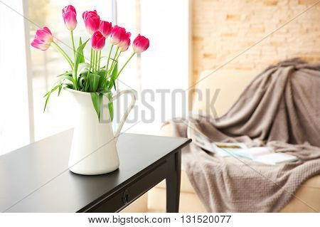 Beautiful bouquet of fresh tulips on wooden table indoors