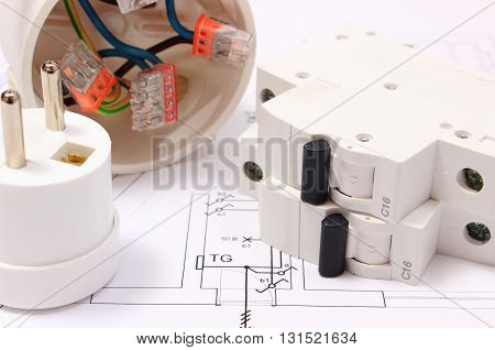 Electric fuse and plug copper wire connections in electrical box on construction drawing of house accessories for engineering work energy concept