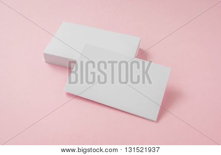 Blank business card on pink background