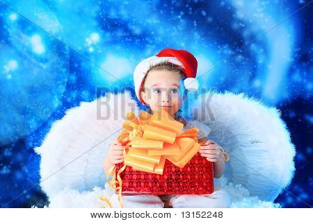 Beautiful little angelic child  with a present at a stellar sky.