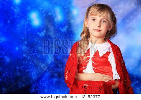 Christmas girl in festive costume over stellar sky.
