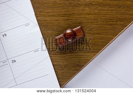 Wooden stamp blank sheet of paper and calendar