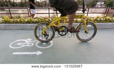 Bike Len And Bike Sign On The Road With Blur Bike
