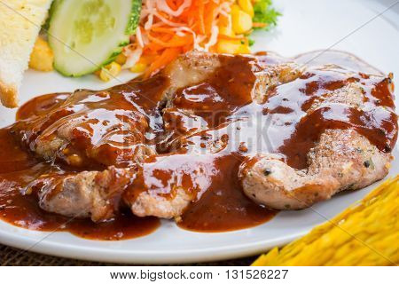 Beef Steak With Black Pepper Sauce , Salad And French Fries On Sack Background