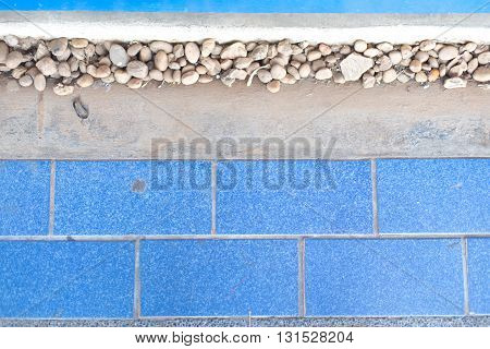 blue tiles and cement floor, top view