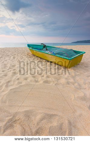 Small Boat On The Beach With Sand Sign For Writing