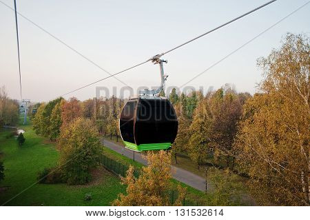 Cable car at autumn park in evening sunset