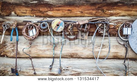 Other small items hanging on the wooden wall of a rural buildings