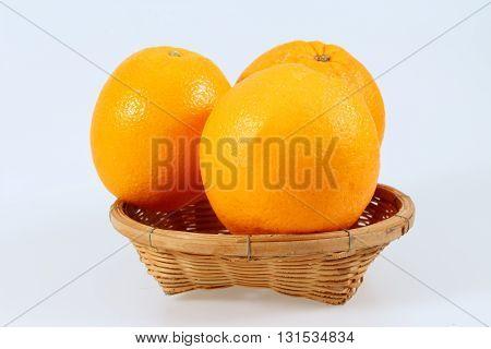 mandarin fruit in the basket isolated on white background