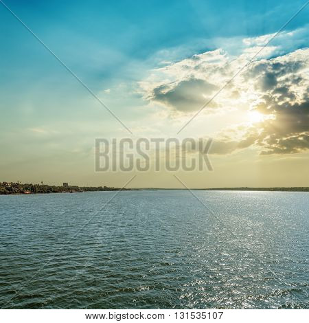 sunset in clouds over river