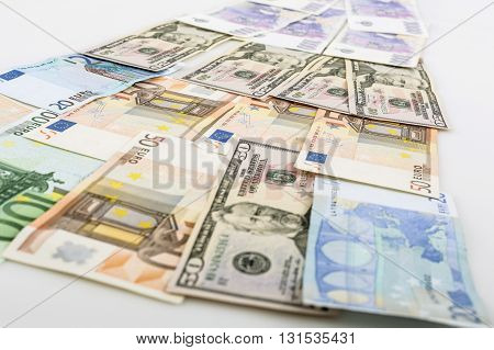 business finance saving and cash concept - close up of euro paper money and coins on table