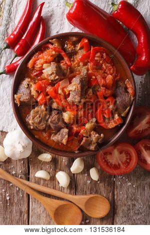 Lamb Cooked With Onion, Tomato And Pepper Closeup. Vertical Top View