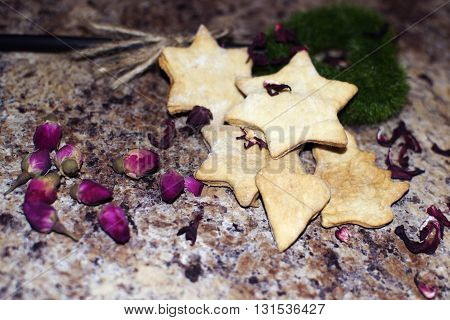 Cookies on table, decorated petals of flowers