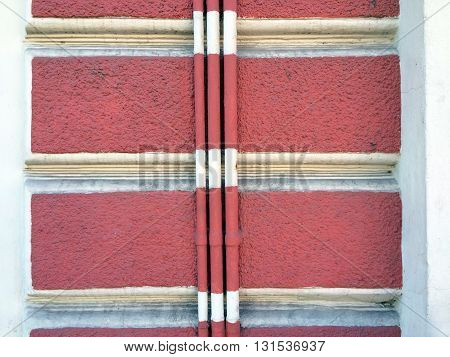 Colored striped wall detail with matching pipes