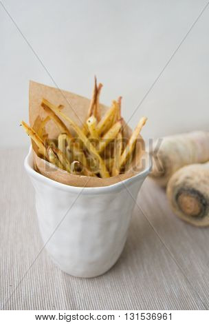No guilt fries - parsley fries in a ceramic jar with paper wrapping