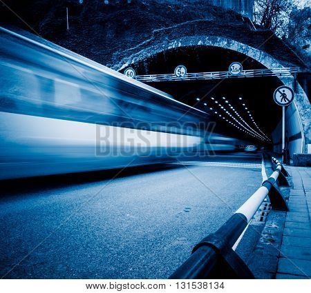traffic in tunnel,chongqing china,blue toned image.