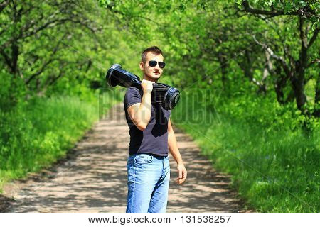 young man with electrical scooter - hoverboard, gyroscooter, portable transport, smart balance wheel