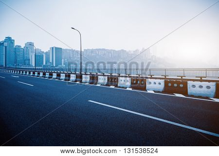view of chongqing skyline while standing at the yangtse river bridge,chongqing china