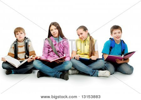 Educational theme: group of teenagers sitting together and reading books.