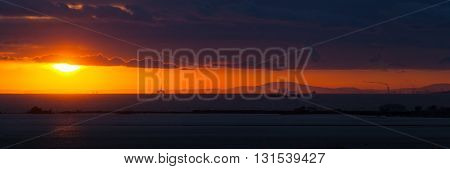 Sunset on the beach. Gold hours becoming blue hours. Landscape on the beach, sitting down sun with heaven.