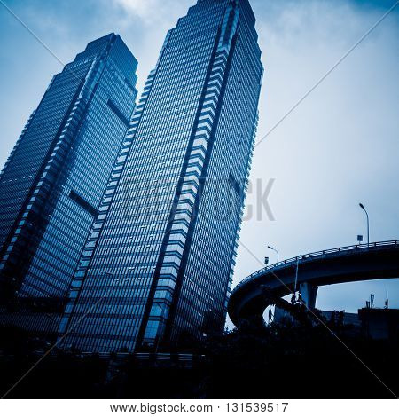 low angle view of chongqing famous twin tower,china,blue toned image.