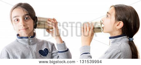 little girl playing on the phone built with the jar