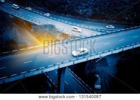 aerial view of traffic on chongqing overpass on a sunny day,china,blue toned image.