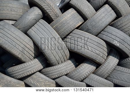 collected old car tires - close-up pattern