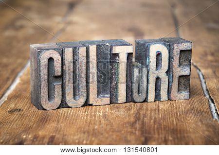 culture word made from wooden letterpress type on grunge wood