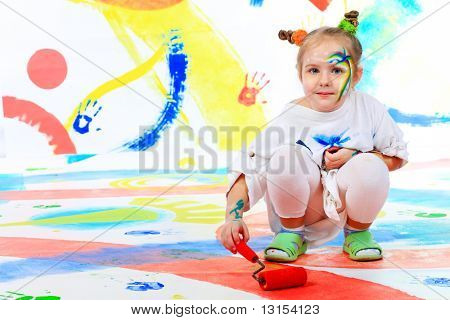 Portrait of a beautiful child enjoying her painting. Education.