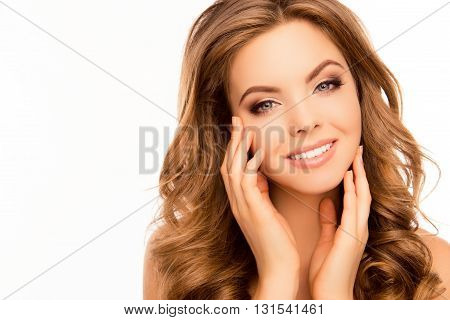Attractive Girl With Beaming Smile And Curly Hairstyle Touching Face