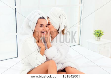 Portrait Of Two Happy Gossips In Bathrobes Having Private Talk