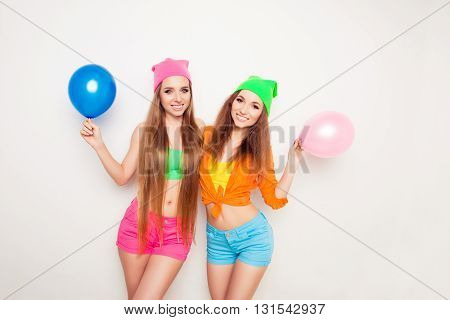 Happy Pretty Women Holding Balloons For Birthday Party