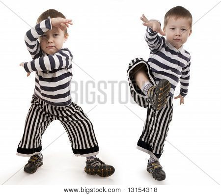 Little Boy Gesticulates Hands And Feet