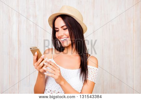 Happy Smiling Woman In Hat Chatting On Mobile Phone