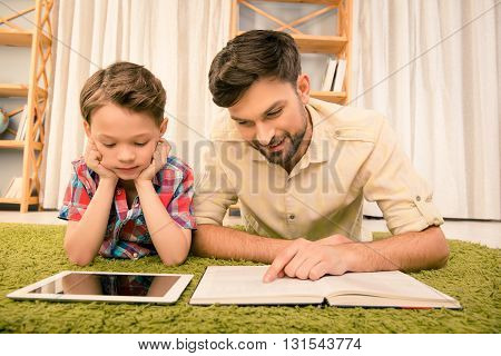 Tablet Vs Book. Father And His Little Son Reading