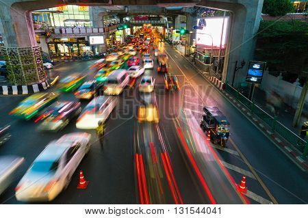 BANGKOK THAILAND - APRIL 22: Cars moving down the road in the heavy traffic conditions at Siam Square on April 22 2016 in Bangkok Thailand.