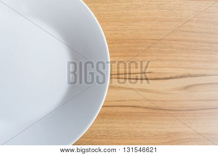 White Dish On Wooden Table Top View