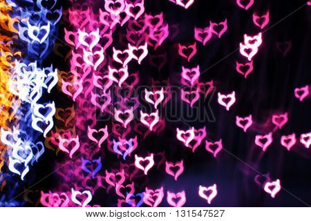 Blurring lights bokeh background of Devil hearts