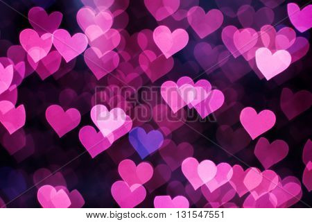 Blurring lights bokeh background of pink hearts