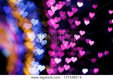 Blurring lights bokeh background of colorful hearts