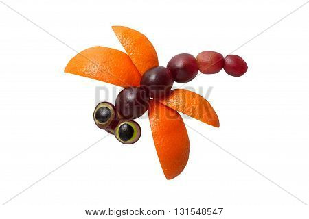 Beautiful dragonfly made of grape and orange