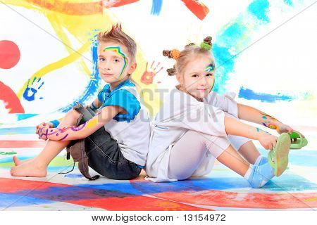 Two beautiful children enjoying their painting. Education.