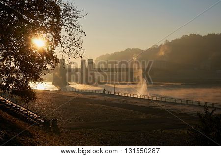 Small old town in sunrise time near river
