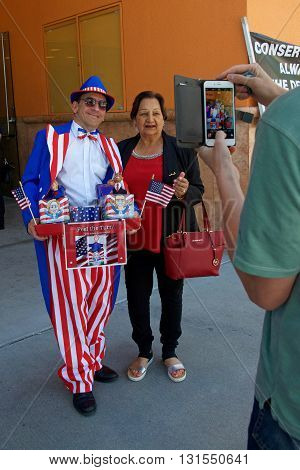 San Jose CA - May 26 2016: Vendor from Pop Art Creations posing for a photo with unidentified participant waiting to enter Parkside Hall for the Hillary Clinton political rally.