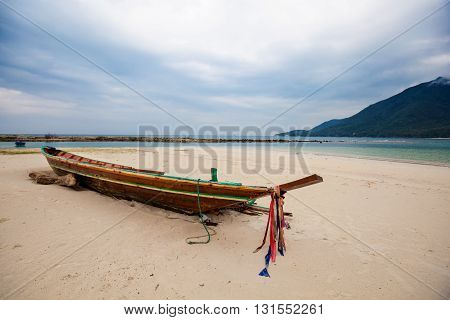 Summer seascape with boat on tropical island Koh Phangan in Thailand. Chalokum beach landscape.
